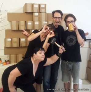 The dignified BS+V team and friend Alessio Corsini standing before the giant tower of box sets